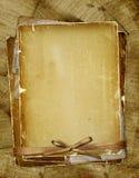 Oude pagina met linten en boog Stock Afbeelding