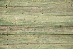 Oude planken met schil groene verf royalty-vrije stock foto's