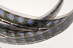 Oude positieve 16 mm-filmstrook op witte achtergrond Royalty-vrije Stock Afbeeldingen