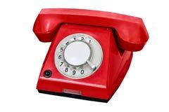 Oude rode die telefoon op witte achtergrond wordt geïsoleerd Stock Foto's
