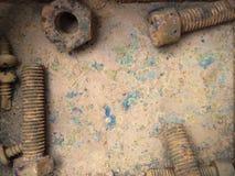 Oude roestige bouten, staal, noten Stock Foto