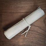 Oude rol op houten lijst royalty-vrije stock afbeelding