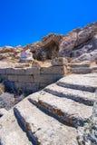 Oude ruïnes in het Eiland Delos in Cycladen, één van de belangrijkste mythologische, historische en archeologische plaatsen stock fotografie