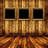 Oude ruimte, grunge binnenland met frames Royalty-vrije Stock Afbeeldingen