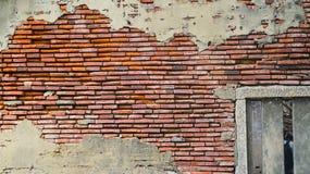 Oude rustieke baksteen en de gebarsten achtergrond van de pleistertextuur stock afbeelding