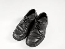 Oude schoolschoenen in zwart-wit Stock Afbeeldingen