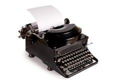 Oude schrijfmachine die op een wit wordt geïsoleerd? Royalty-vrije Stock Foto