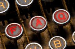 Oude schrijfmachine en faq sleutels Royalty-vrije Stock Foto's