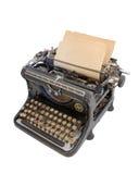 Oude schrijfmachine met een blad van document stock afbeelding
