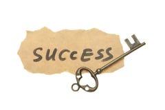 Oude sleutel en succeswoorden Stock Foto's