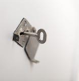 Oude sleutel in sleutelgat Stock Foto's