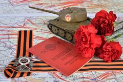 Oude Sovjet militaire identiteitskaart, orde van de Patriottische Oorlog in St Georg Stock Foto