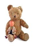 Oude speelgoed, teddybeer en poppenjongen Royalty-vrije Stock Foto's