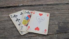 Oude speelkaarten op houten achtergrond Royalty-vrije Stock Foto