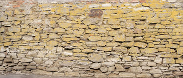 Oude steenachtige muur stock afbeeldingen