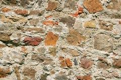 Oude steenachtige muur stock foto's