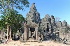 Oude steengezichten op een tempel Stock Foto