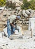 Oude steenmetselaar stock foto's