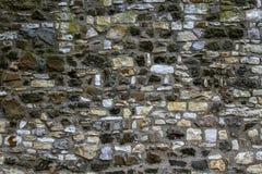 Oude steenmuur als achtergrond of textuur Stock Fotografie