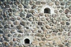 Oude steenmuur van kasteel Stock Afbeeldingen