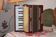 Oude stoffige harmonika royalty-vrije stock afbeelding
