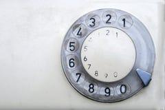 Oude telefoon met wijzerplaatschijf Stock Foto