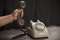 Oude telefoon op een lijst Stock Foto
