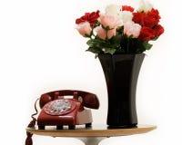 Oude telefoon thuis stock afbeelding