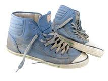 Oude tennisschoenen Stock Afbeelding