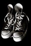 Oude tennisschoenen Royalty-vrije Stock Afbeeldingen