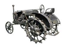 Oude tractor die over witte achtergrond wordt geïsoleerde Stock Fotografie