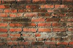 Oude uitstekende bakstenen muurachtergrond Stock Afbeelding