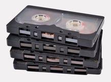 Oude uitstekende cassettebanden op een wit Stock Foto