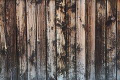 Oude uitstekende dark bevlekt houten plankenachtergrond Stock Foto's