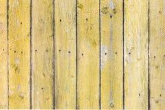 Oude uitstekende gele geschilderde houten textuurachtergrond stock foto's