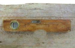 Oude uitstekende houten waterspiegel op hout Stock Foto's