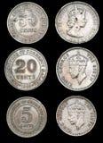 Oude uitstekende muntstukken Stock Foto's