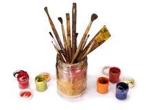 Oude verfborstels in een kruik Stock Fotografie