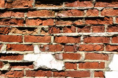 Oude vernietigde bakstenen muurachtergrond Stock Foto