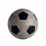 Oude Voetbalbal in de studio stock afbeelding