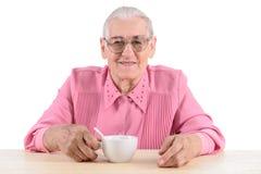 Oude vrouw andcup van thee Royalty-vrije Stock Afbeelding