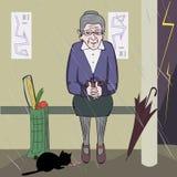 Oude vrouw die een katje voeden stock fotografie