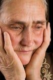 Oude vrouw in droefheid Stock Afbeelding