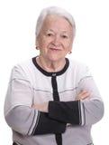 Oude vrouw met gekruiste handen royalty-vrije stock afbeelding
