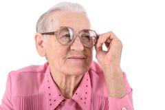 Oude Vrouw met glazen Stock Foto