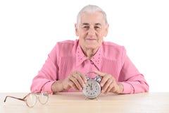 Oude vrouw met klok Stock Foto's