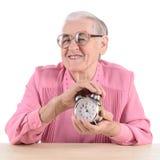Oude vrouw met klok Royalty-vrije Stock Afbeeldingen