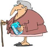Oude vrouw met tanden in een glas Stock Fotografie