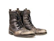 Oude vuile laarzen royalty-vrije stock afbeelding