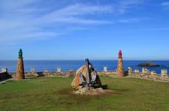 Oude vuurtorens in zeehaven van Tapia, Asturias, Spanje Stock Foto